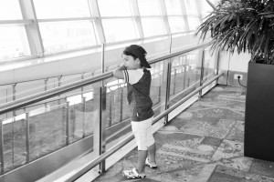 The aeroplane adulator. Ayaan, seen here as a content soul to have a grand view of aeroplanes through the glass walls of IGI airport.