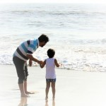 Waiting for the next wave with papa :)