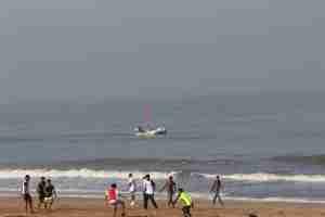 Beach, ball, boys and boat :)